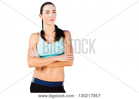 Sporty woman posing with her arms crossed