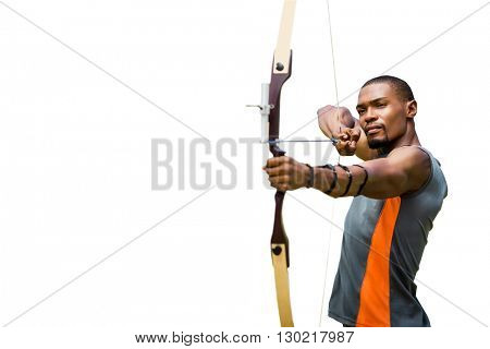 Front view of sportsman is practising archery
