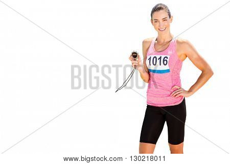 Portrait of sporty woman holding chronometer