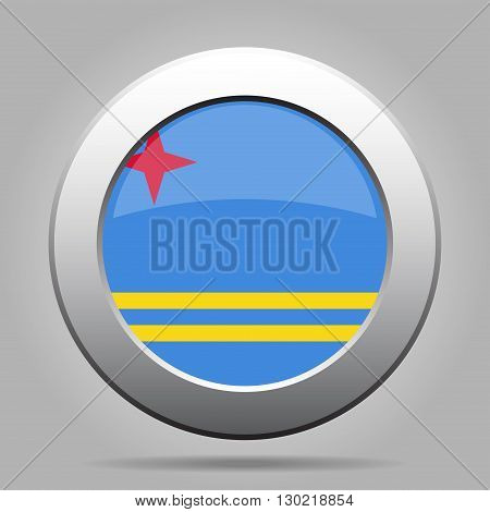 metal button with the national flag of Aruba on a gray background