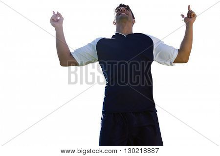 Low angle view of sportsman is smiling and raising arms
