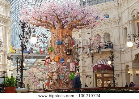 MOSCOW - APRIL 13: The interior decorated artificial tree birds and birdhouses in GUM store on April 13 2016 in Moscow. GUM is the large store in the Kitai-gorod part of Moscow facing Red Square.