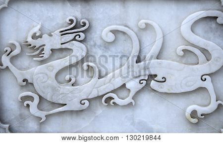 A Chinese dragon carved into white marble at the Confucius Temple within Beijing China.