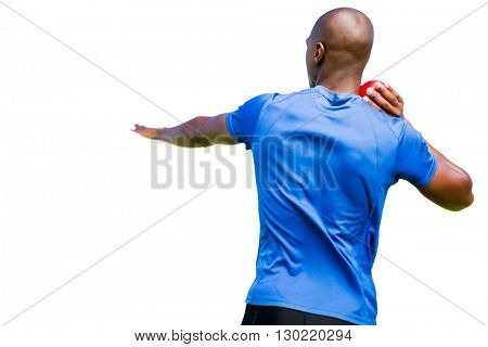 Rear view of sportsman is practising shot put
