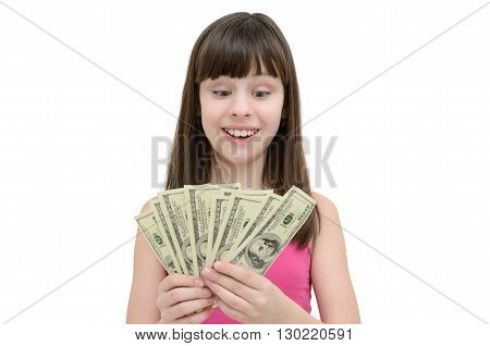 Girl in amazement holding money on white background