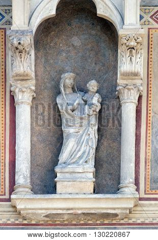 FLORENCE, ITALY - JUNE 05: Virgin Mary with baby Jesus, Loggia del Bigallo on Piazza San Giovanni in Florence, Italy, on June 05, 2015