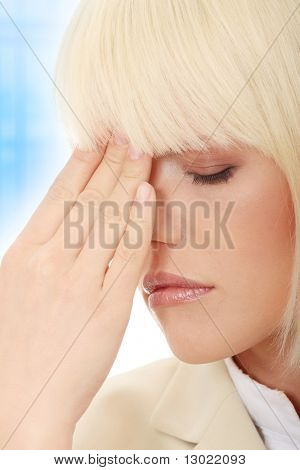 Young business woman with headache,Over abstract blue background