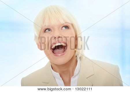 Young business woman shouting,Over abstract blue background