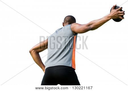 Low angle view of sportsman is practising discus throw