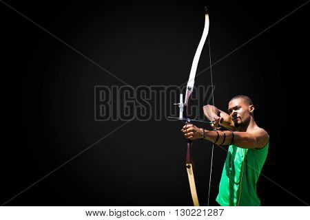Facing view of man practicing archery against white background