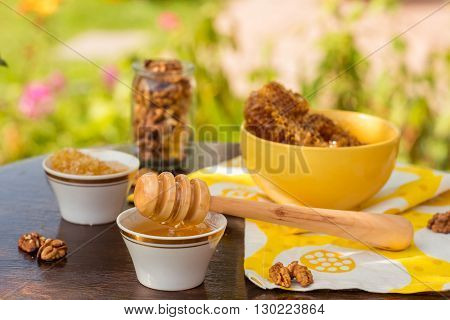 colorful outdoors photo of honey and nuts