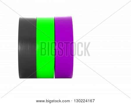 Black, green, purple insulating tape rolls, isolated on white background
