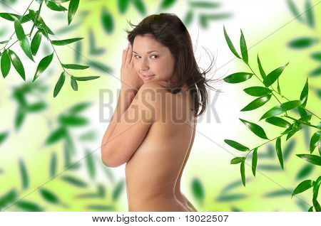 Nude beauty model in studio with hair blown by wind