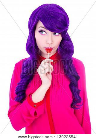 Portrait Of Dreaming Woman With Purple Hair Wig Licking Lollipop Isolated On White