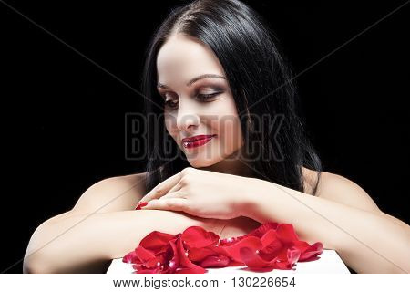 Sexy Looking Caucasian Brunette Woman Posing Against Black Background. Horizontal Image
