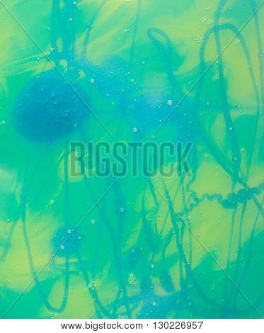 Abstract Blue-Yellow- Turquoise Background Made with Paint Shampoo Glass and Paper and Creating Textured Splashes Spots and Lines