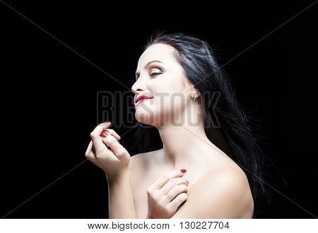 Sensual and Dreaming Caucasian Brunette Woman. Posing Against Black. Horizontal Image