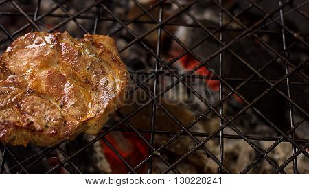 cooking marinade meat on the grill, close up view