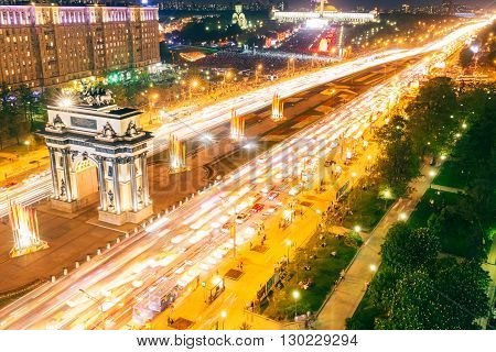 Triumphal Arch Victory Park and the alley of fountains in Moscow a summer night