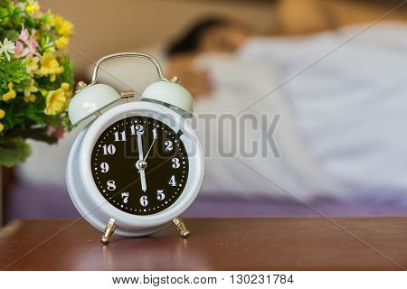Alarm Clock On The Bed In Bedroom