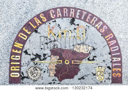 MADRID SPAIN - MARCH 22 2016: Kilometre zero sign in Madrid Spain. The sign in on the pavement on Puerta del Sol square. It is a starting point for measuring distance in Spain.