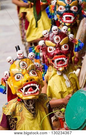 Unidentified monks with drums performs a religious masked and costumed mystery dance of Tibetan Buddhism during the Cham Dance Festival in Hemis monastery India.