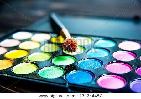 Makeup palette with makeup brush. Makeup background