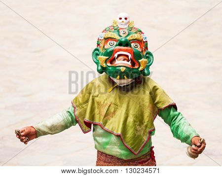 Hemis India - June 29: unidentified monk with ritual bell and vajra performs a religious masked and costumed mystery dance of Tibetan Buddhism during the Cham Dance Festival on June 29 2012 in Hemis monastery India.