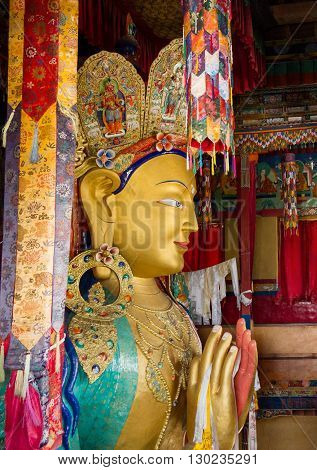Upper part of the Giant statue of Maitreya Buddha (the largest statue in Ladakh which occupies two floors of the building) in the Thikse Monastery near Leh (Ladakh Jammu and Kashmir north India)