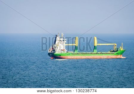 Cargo Ship in Sea at Sunny Day