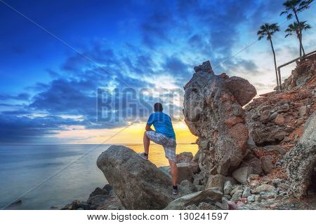 Man watching sunset over atlantic ocean at Gran Canaria island,