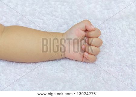 Stranglehold Hand Of The Baby On White Diapers