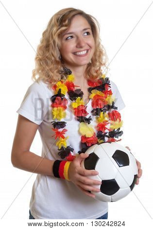 German female soccer fan with ball looking sideways on an isolated white background for cut out