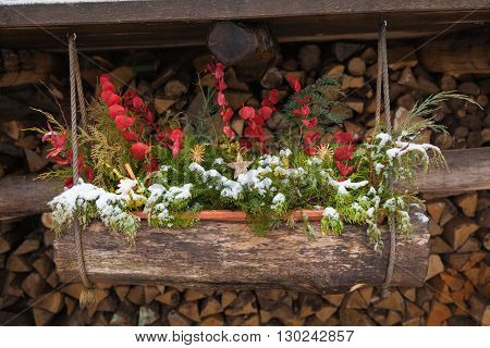 box with Christmas decoration hanging on wooden beams