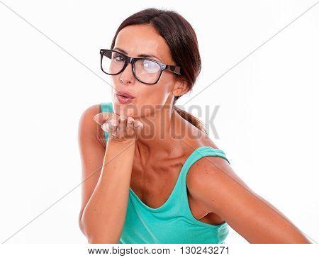 Adult Caucasian Woman Blowing A Kiss