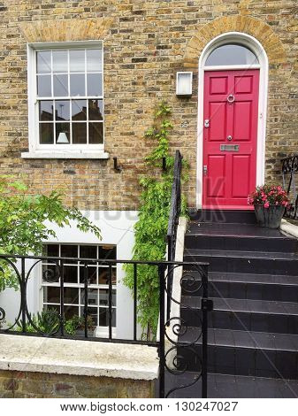 LONDON - MAY 18: Smart house entrance with pink front door on May 18, 2016 in Hampstead, London, UK.