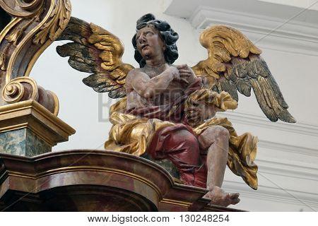 KOTARI, CROATIA - SEPTEMBER 16: Angel on the altar in the church of Saint Leonard of Noblac in Kotari, Croatia on September 16, 2015.