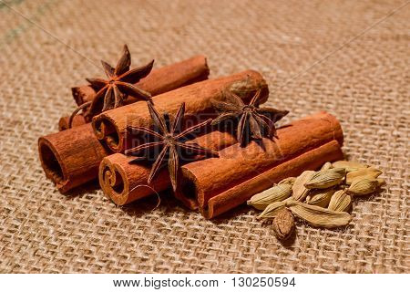 decor spices cinnamon and anise many more with brown sackcloth background