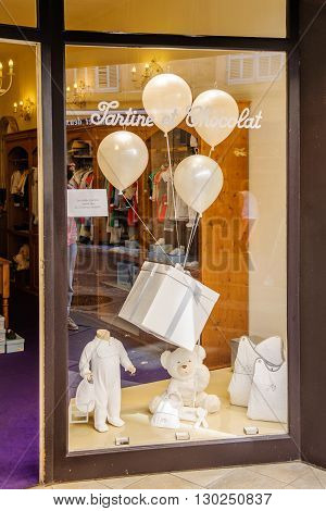 AIX-EN-PROVENCE FRANCE - JUL 17 2014: Tartine et Chocolate kids fashion store in the center of Aix city on a summer day on 10 rue d'Italie