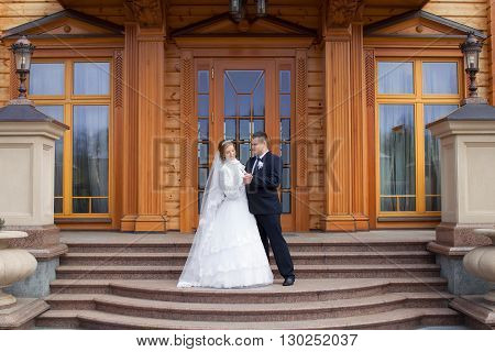 happy beautiful bride and groom walking on field. Loving wedding couple outdoor. Bride and groom.Wedding concept.