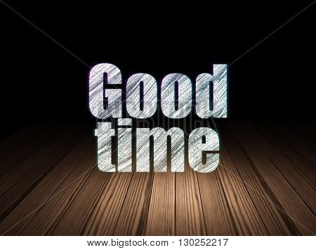 Timeline concept: Glowing text Good Time in grunge dark room with Wooden Floor, black background