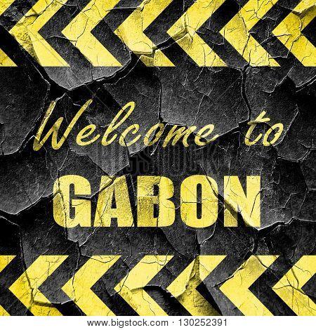 Welcome to gabon, black and yellow rough hazard stripes