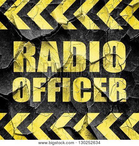radio officer, black and yellow rough hazard stripes