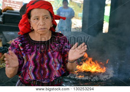 CHICHICASTENANGO GUSTEMALA APRIL 29 2016: Woman shaman in Guatemala, Mayan presence is so strong and rituals are shaped by traditions that go back to the time of Tikal.