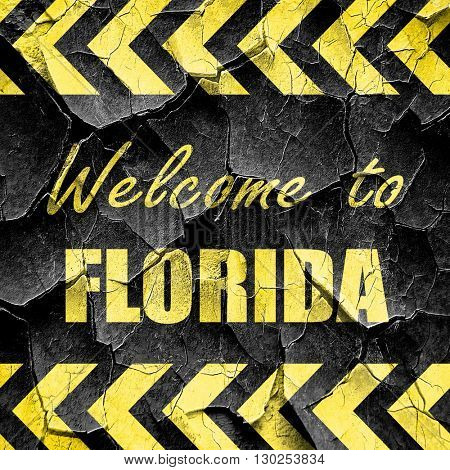 Welcome to florida, black and yellow rough hazard stripes