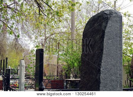old cemetery in the forest, marble gravestones