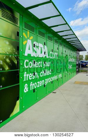 EDINBURGH, SCOTLAND - MAY 15, 2016: Asda Collection Point at a fuel station in Newbridge near Edinburgh. Customers can order online and collect groceries at Click and Collect Lockers.