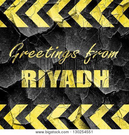 Greetings from riyadh, black and yellow rough hazard stripes