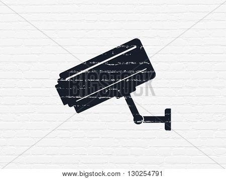 Security concept: Painted black Cctv Camera icon on White Brick wall background
