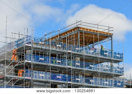 GLASGOW SCOTLAND - MAY 16 2016: Plettrac Metrix scaffold system being used at a residential property development site in Glasgow Scotland.